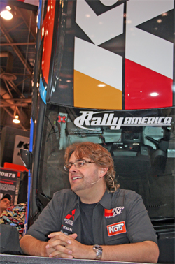 Rally Racer Andrew Comrie-Picard at K&N booth at SEMA in Las Vegas, Nevada