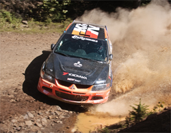 2007 Mitsubishi Lancer Evolution IX and Andrew Comrie-Picard will return to the United States for Rally America Round 8 in Steamboat Springs, Colorado