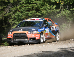 Racer Andrew Comrie-Picard in Mitsubishi Lancer Evolution X at Canada's Rallye Defi Ste-Agathe, photo by onalimbracing.com