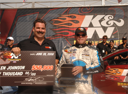 K&N Vice President of Research and Development Steve Williams presents $50,000 to Pro Stock driver Allen Johnson who won the 2008 K&N Horsepower Challenge