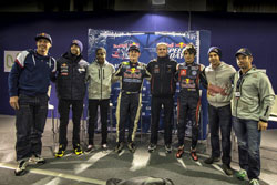 Grinchuk stands in the middle of an impressive gathering of motorsport all-stars.