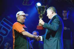 Aleksandr Grinchuk is presented his third consecutive Drift King trophy by the president of the Federation of Autosport of Ukraine (FAU).