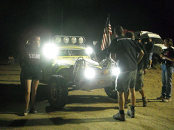 While racing in the 2013 General Tire Vegas to Reno race, Alexander Motorsports and their competitors raced during daylight and under darkness. in a rugged and unforgiving desert terrain