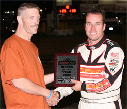 Presenter Steve Cox gives Jonathan Allard the MSPA Open Wheel Oval Track Driver of the Year Award