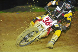 Adam churning up the muck in a race at Galesburg, Illinois last year.