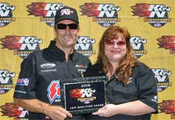 K&N's Tamra Bradley presents Greg Anderson with K&N Horsepower Challenge low qualifier award at Bandimere Speedway