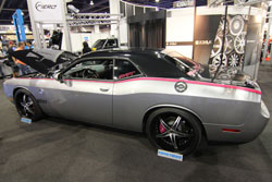 Pink striped Dodge Challenger for cancer awareness at SEMA