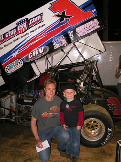 Andy Forsberg in front of the F&F X1 360 Sprint Car and a Fan