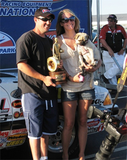 Rick Baehr, wife Sarah Baehr and dog Sasha after his first NHRA National Event win