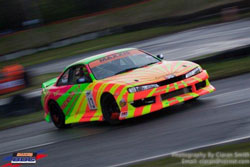 You could hardly miss the retina-burning color scheme of Dan O'Brien car.