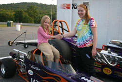 With a simple handshake Heather bestows the Junior Dragster to youngest sister and newest team member Amber.