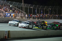 Ben Kennedy and Gray Gaulding lead the pack during K&N Pro Series East race at Five Flags Speedway