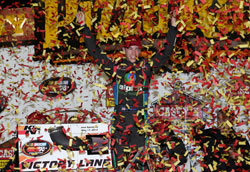 Ben Rhodes celebrates winning the NASCAR K&N Pro Series East at the Iowa Speedway