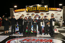 Ben Rhodes and his Turner Scott Motorsports team celebrating in Victory Lane