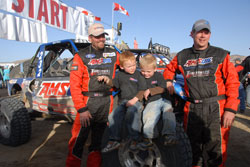 At the finish line of the King of Hammers race it's Lovell, his twin three-year-old boys Adam and Byam, and Bill Kunz (left to right)