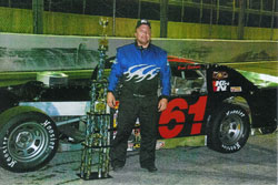 Brad Sprionger poses with his trophy after recently winning the 2011 points race at the Angola Speedway.