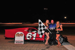 Brad Springer enjoys the spoils of victory after his recent Modified win at Springport Motor Speedway.