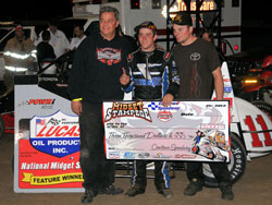 Brady Bacon recently earned the checkered flag at the Midget Stampede in Dallas, at the Cowtown Speedway.