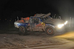 At 3:27am Saturday morning the No. 70 Menzies/Red Bull Trophy Truck crossed the finish line in first place.