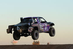 Bryce Menzies and his off-road truck catching some air.