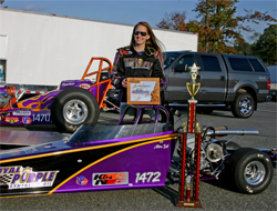 Allison Bell and her Junior Dragster Trophy at Maple Grove Raceway in Mohnton, Pennsylvaniay