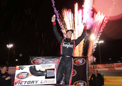 Cameron Hayley celebrating his win at the All American Speedway in Roseville, CA