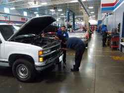 Students at Universal Technical Institute perform maintenance and repair work on the Million Mile Truck.