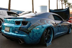 This Camaro SS combines tribal designs with ghost like images on a bright blue background at SEMA