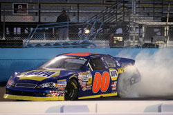 Cole Custer celebrates with a burn out after winning the NASCAR K&N Pro Series West at Phoenix International Raceway
