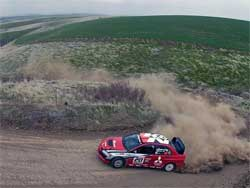 Andrew Comrie-Picard drives his Mitsubishi Lancer Evolution 1X at Olympus  Rally, photo by Warick Patterson/Flatovercrest.com