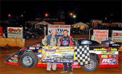 Ray Cook in Victory Lane with a $4,000 Payday for winning the Grand Adcox Memorial at the historic Cleveland Speedway in Tennessee, photo by Action Shots and Graphics