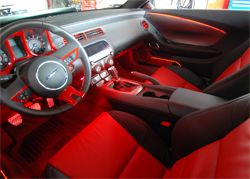 2010 Camaro's interior features seem to glow from accent lighting and placement of red LED lights