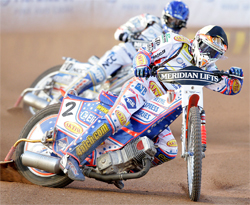 Jason Crump followed Sweden's Fredrik Lindgren during tough track conditions at Swedish Grand Prix, photo by Mike Patrick