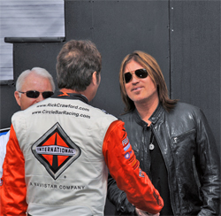 Camping World Truck Series Driver Rick Crawford meets country music star Billy Ray Cyrus at Auto Club Speedway in California