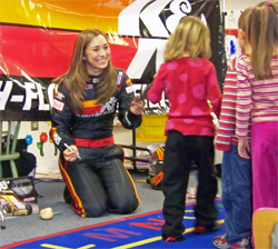 K&N Development Driver Caitlin Shaw also volunteers at children's hospitals and libraries when she is not volunteering in the classroom