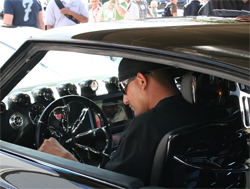 Custom steering wheel by Dave Fishman Rivera compliments the all black interior and trunk with eather and ostrich skin