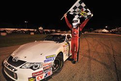 Daniel Suarez celebrates his win in the NASCAR K&N Pro Series East race at Columbus Motor Speedway.