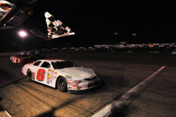 Daniel Suarez crosses the finish line at Columbus Motor Speedway for his first NASCAR K&N Pro Series East victory.