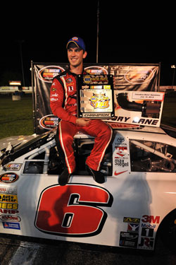 Daniel Suarez shows off his trophy after winning the NAPA 150 at Columbus Motor Speedway