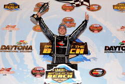 Daniel Suarez celebrates in victory lane after winning NASCAR K&N Pro Series East UNOH Battle at Daytona International Speedway