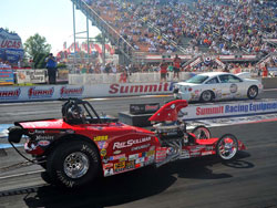 David Rampey drives a red '32 Bantam roadster in the NHRA Competition Eliminator class