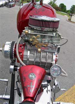 Custom motorcycle with K&N air filter on top of four barrel Holley carburetor