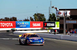 Derek Thorn takes the checkered flag at Sonoma Raceway.
