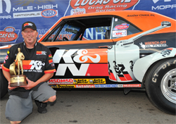 Dan Fletcher holds his 61st NHRA Wally from the Mopar Mile High Nationals at Bandimere Speedway in Morrison, Colorado