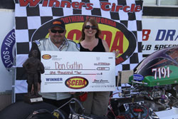 Drag Racing's Don Gatlin collects his $1,000 check.