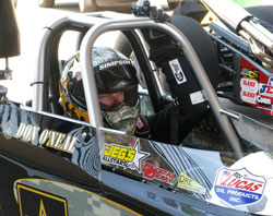 Nothing but pure focus and determination in the eyes of Don O'Neal behind the wheel of his Army/K&N dragster.