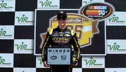 Dylan Kwasniewski won the pole then continued to victory lane in the NASCAR K&N Pro Series East race at Virginia International Raceway.