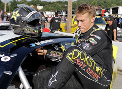 NASCAR K&N Pro Series West racer Dylan Kwasniewski climbs into his Rockstar Energy/Royal Purple #98 Chevy Impala at Greenville Pickens Speedway