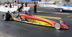 Getting closer to a chance to make drag racing history, Jacob ever-so-carefully stages his 2003 Racetech during the final round of Box E.T.