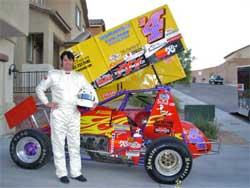 Race winner, Elvis impersonator Joey Franklin, next to his sprint car